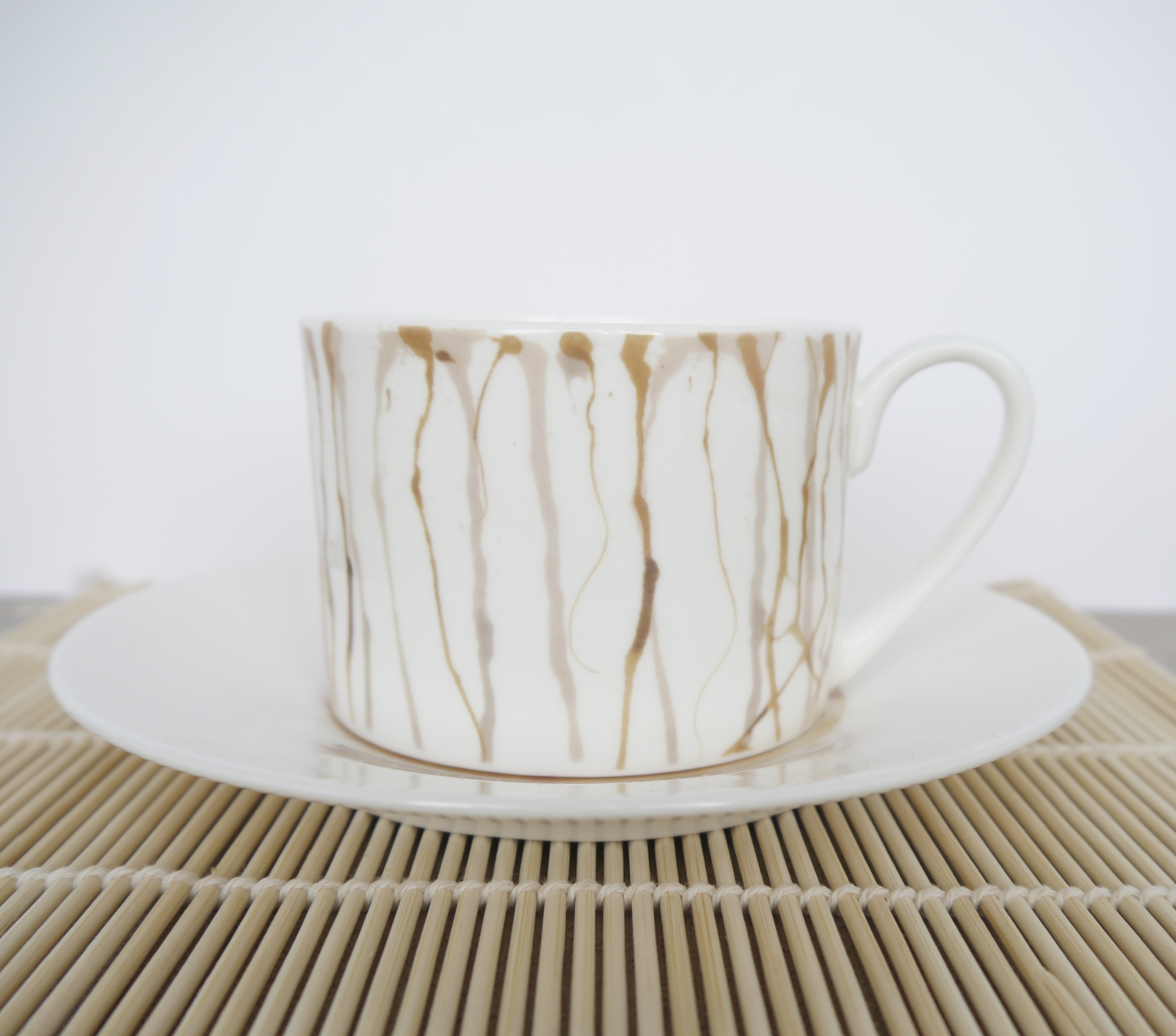 Bone china teacup and saucer with spill design - Victoria Mae Designs